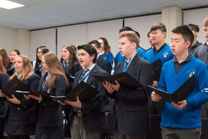 Students singing in the choir