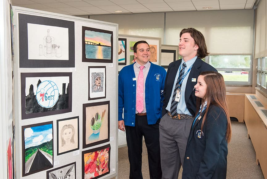 Students looking at class artwork